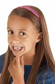 stock photo of missing teeth  - girl pointing at missing tooth pink headband - JPG