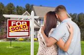 stock photo of army  - Sold For Sale Real Estate Sign and Affectionate Military Couple Looking at Nice New House - JPG