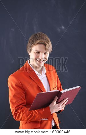 Smiling young teacher holding scoreboards