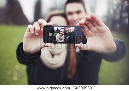 Cute Young Couple Taking A Self Portrait