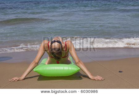 Woman Relaxing On An Air Mattress
