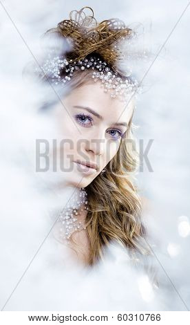 beauty young snow queen in fairy flashes with crown on her head