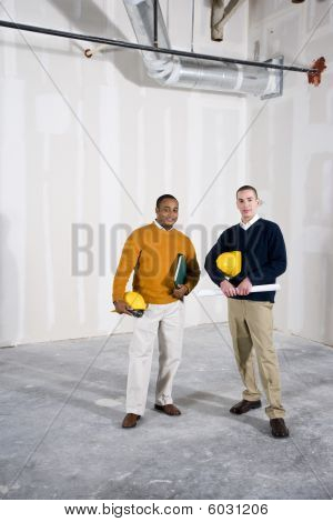 Multi-ethnic men in office space ready for buildout