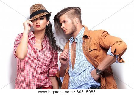 relaxed man playing with girlfriend's hair in studio