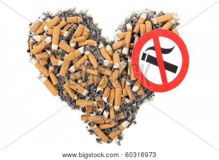 Broken heart and cigarette butt on a white background