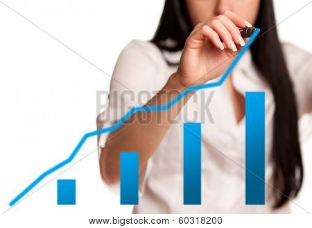 Business woman drawing an chart on glass