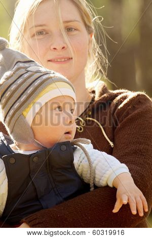 Baby outdoors close to nature and have fun
