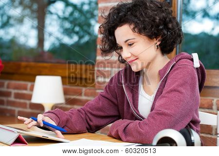 Young Girl Working On Tablet.