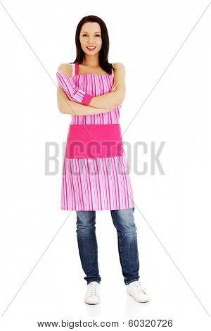 Young housewife in appron, isolated on white background