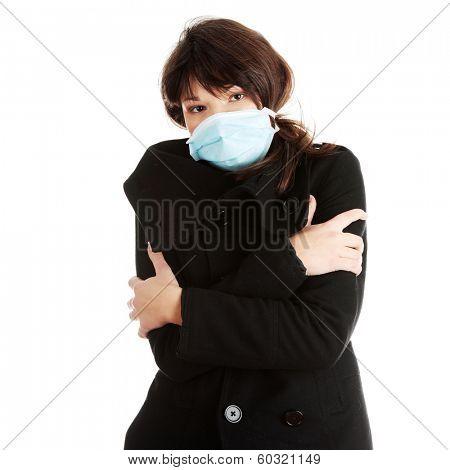 A glamorous model wearing a mask to prevent 'Swine Flu' infection. Isolated