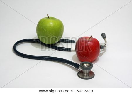 Two apples and stethoscope