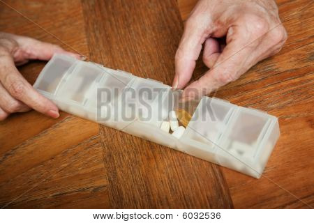 Woman Reaching For Daily Supplement