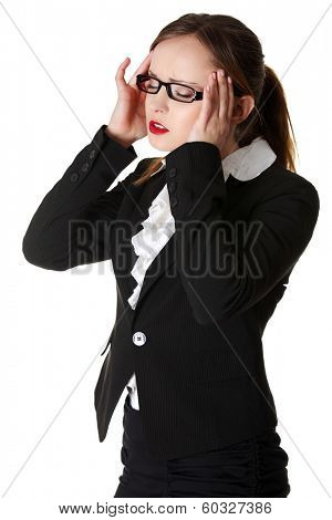 Business woman heaving headache,isolated on white.