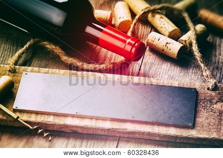 Rustic Setting With Red Wine Bottle And Corks