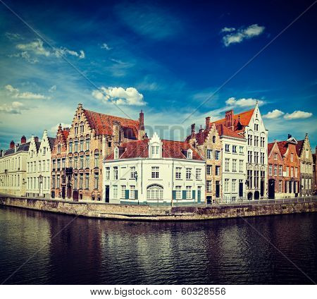 Vintage retro hipster style travel image of Benelux travel  concept background - Bruges canal and medieval houses. Brugge, Belgium