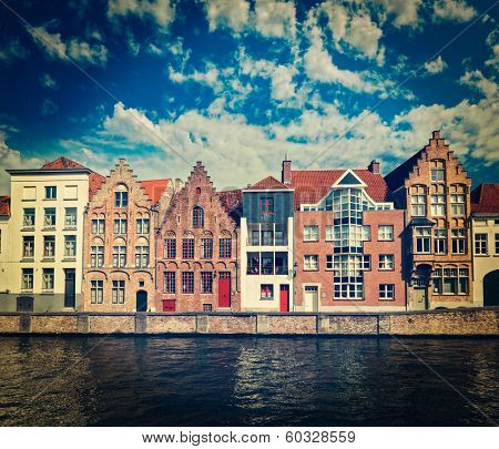 Vintage retro hipster style travel image of canal and medieval houses. Bruges (Brugge), Belgium