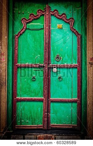 Retro hipster styled image of wooden old door vintage texture background