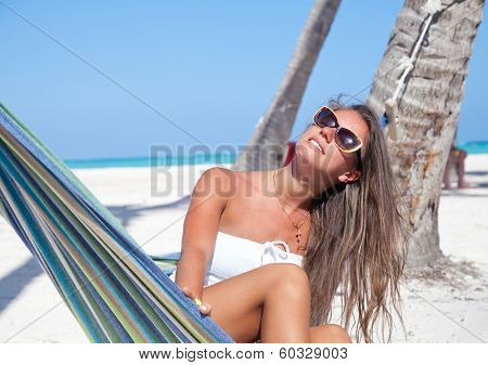 Young Woman Lying In A Hammock On A Beach