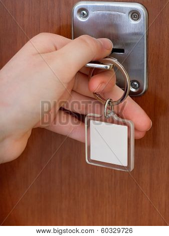 Closing House Door By Key With Blank Keychain