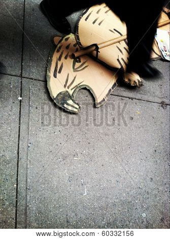 NEW YORK CITY - NOV 17, 2011: Pedestrian on Nassau Street walks over a discarded rat sign from an Occupy Wall Street protest.