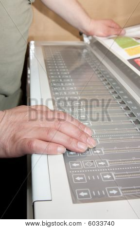 Worker's Hands On The Electronic Control Panel