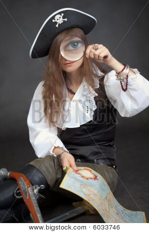 Woman In Clothes Of Pirate With Sea Map And Magnifier Glass
