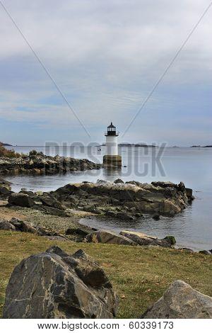 Lighthouse on rocky coast in Salem, Massachusetts