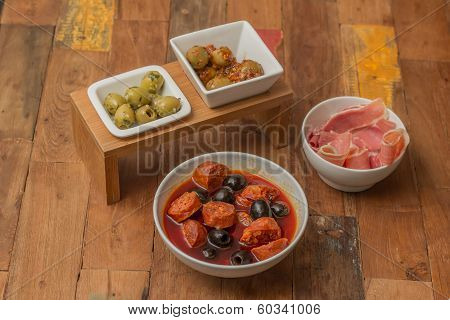 Traditional Spanish Tapas: Chorizo, Ham And Olives