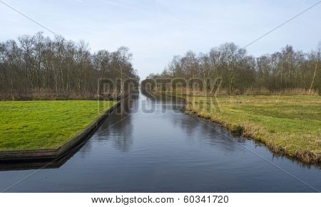 Canal through wetland in winter