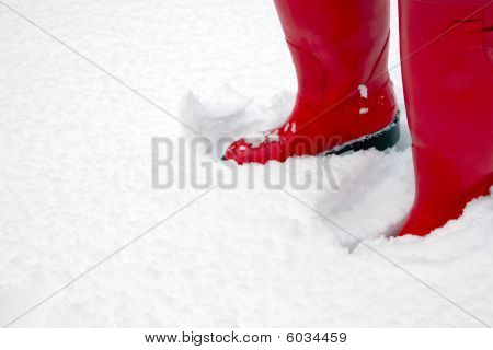 Red Wellington Boots In The Snow