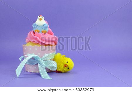 Happy Easter pink, blue and yellow cupcakes