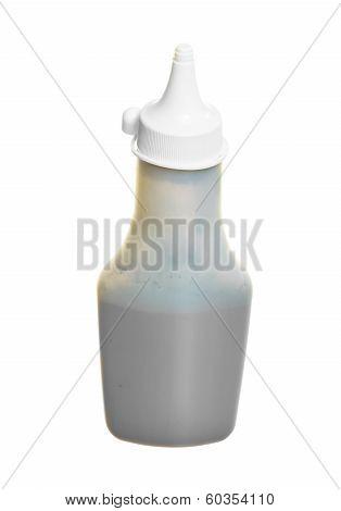 Bottle Of Toner Isolated On White. Technology Equipment.