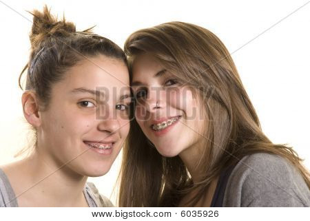Two Girls Friends On A Studio Shot