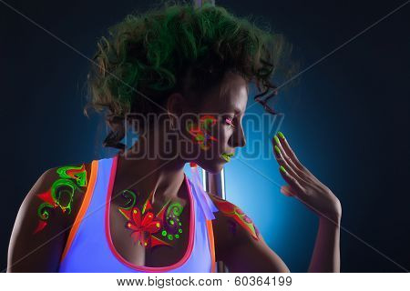 Portrait of artistic dancer with bright uv makeup