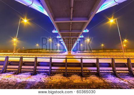 Architecture of bridge over bypass in Gdansk at night, Poland