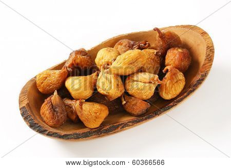 dried figs in a wooden tray