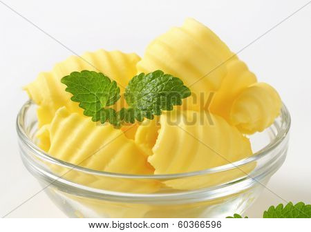 bowl with margarine curls, decorated with mint