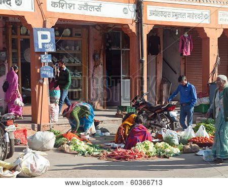 JAIPUR INDIA - JANUARY 29: Seller selling the vegetables in Jaipur street on January 29 2014 in Jaip