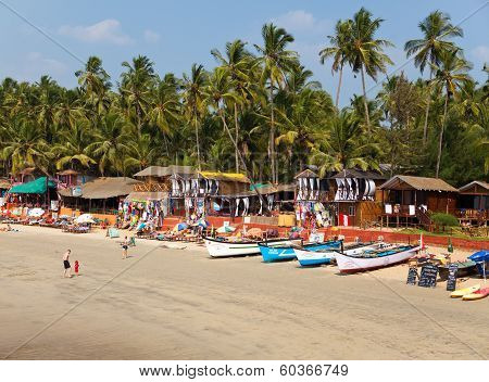 GOA INDIA - JANUARY 31:Vacationers sellers cafe on the tropical beach Palolem on January 31 2014 in