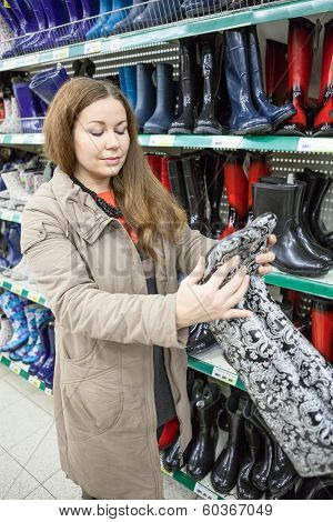 Pretty Woman Looking At Watertights When Buying In Shop