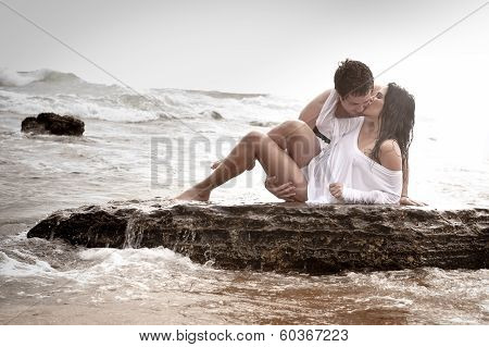 young sexy couple kisisng on beach