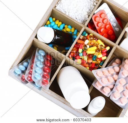Medical pills, ampules in wooden box, isolated on white