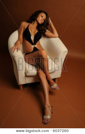 Black swimsuit white chair