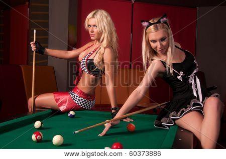 Girls playing in billiard