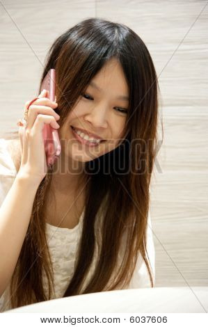 Girl Laughing On Phone
