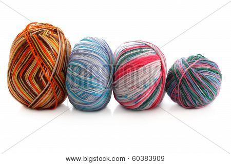 Melange Few Balls Of Wool On A White Background
