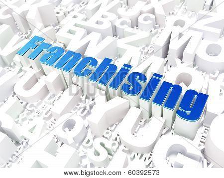 Business concept: Franchising on alphabet background