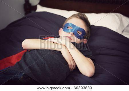 Boy superhero sleeping