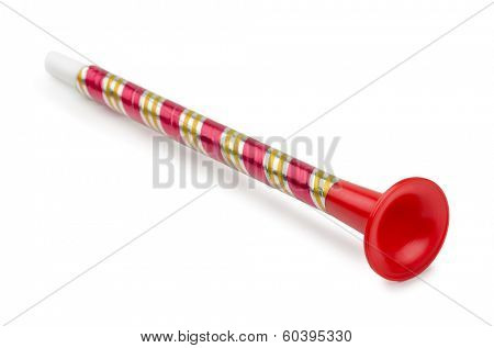 Red plastic toy horn isolated on white