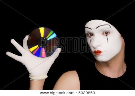 Portrait Of  Mime With Cd On  Black Background